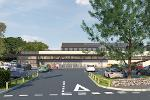 Ivybridge Regeneration Plans Visualisation shows a road leading towards an Aldi store with a car park in front of it.