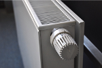 Top shot of the grill of a white central heating wall radiator