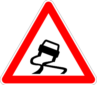 A red warning triangle with a skidding vehicle graphic