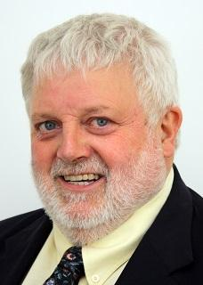 A portrait photo of the late Cllr David May
