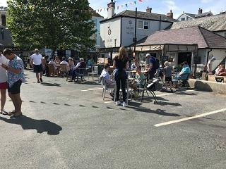 A public open air cafe at Whitestrand in Salcombe on a sunny day